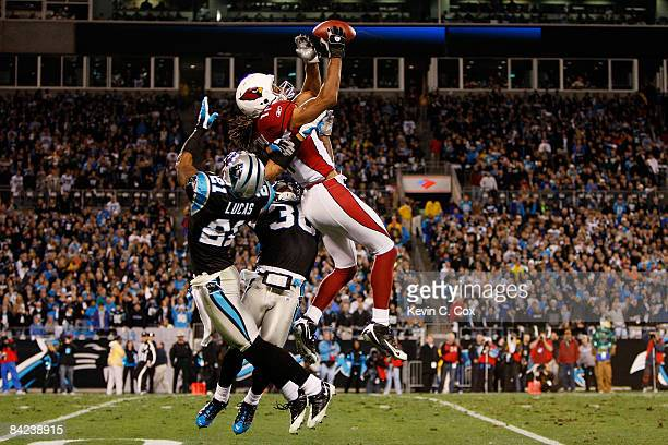 Wide receiver Larry Fitzgerald of the Arizona Cardinals catches a pass against the Ken Lucas of the Carolina Panthers during the NFC Divisional...