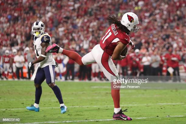 Wide receiver Larry Fitzgerald of the Arizona Cardinals catches a touchdown ahead of cornerback Kayvon Webster of the Los Angeles Rams during the NFL...