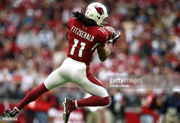 Wide Receiver Larry Fitzgerald of the Arizona Cardinals catches the ball against the St. Louis Rams during their NFL Game on December 7, 2008 at the...