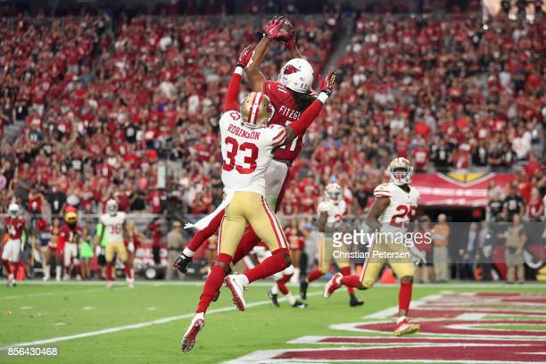 Wide receiver Larry Fitzgerald of the Arizona Cardinals catches the game-winning touchdown in overtime over cornerback Rashard Robinson of the San...