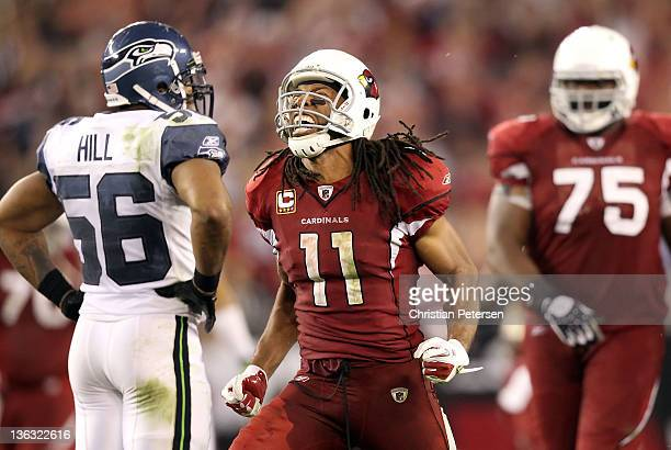 Wide receiver Larry Fitzgerald of the Arizona Cardinals celebrates after a reception in overtime against the Seattle Seahawks during the NFL game at...