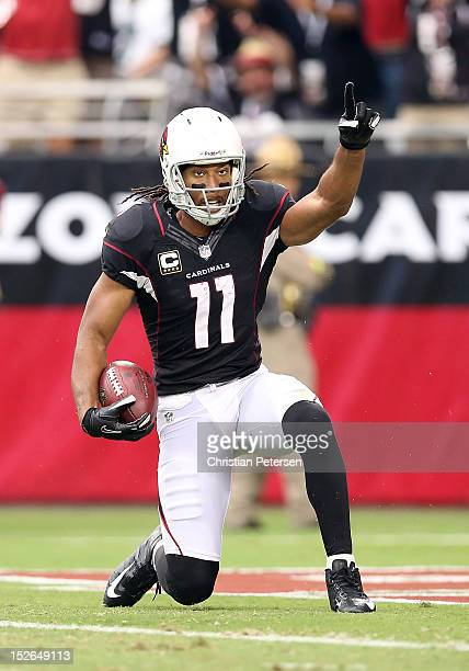 Wide receiver Larry Fitzgerald of the Arizona Cardinals celebrates after a 37 yard touchdown reception against the Philadelphia Eagles during the...