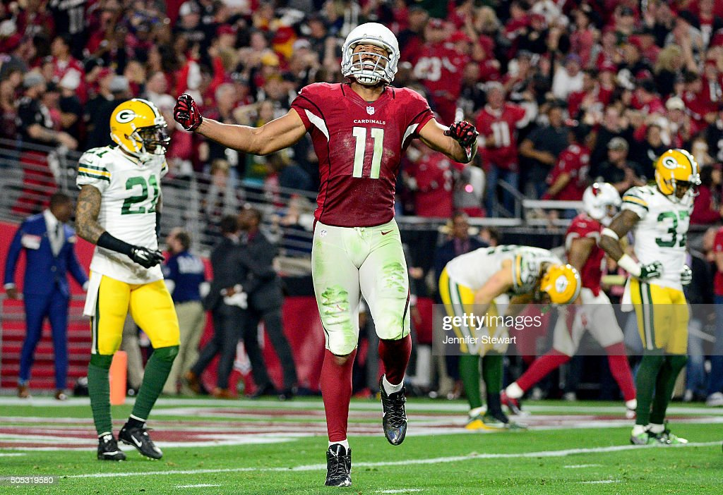 Wide receiver Larry Fitzgerald #11 of the Arizona Cardinals celebrates after a 75-yard run in overtime of the NFC Divisional Playoff Game at University of Phoenix Stadium on January 16, 2016 in Glendale, Arizona. The Arizona Cardinals beat the Green Bay Packers 26-20.