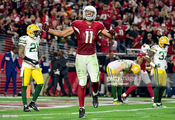 Wide receiver Larry Fitzgerald of the Arizona Cardinals celebrates after a 75yard run in overtime of the NFC Divisional Playoff Game at University of...
