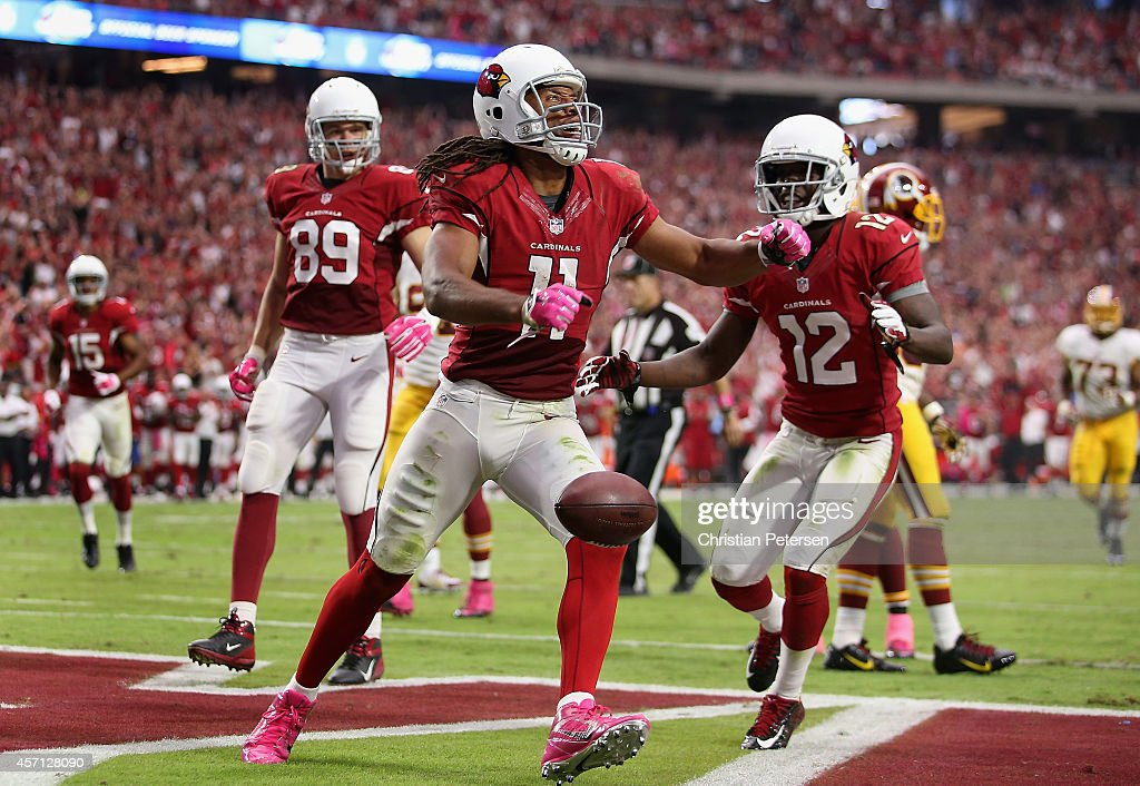 Wide receiver Larry Fitzgerald #11 of the Arizona Cardinals celebrates alongside John Brown #12 after scoring on a 24 yard touchdown reception against the Washington Redskins during the second quarter of the NFL game at the University of Phoenix Stadium on October 12, 2014 in Glendale, Arizona.