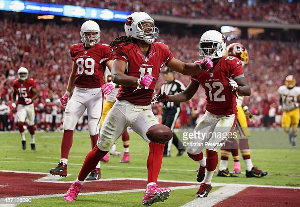 Wide receiver Larry Fitzgerald of the Arizona Cardinals celebrates alongside John Brown after scoring on a 24 yard touchdown reception against the...