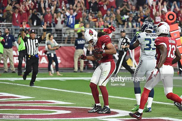 Wide receiver Larry Fitzgerald of the Arizona Cardinals celebrates after scoring a 17 yard touchdown against the Seattle Seahawks in the second...