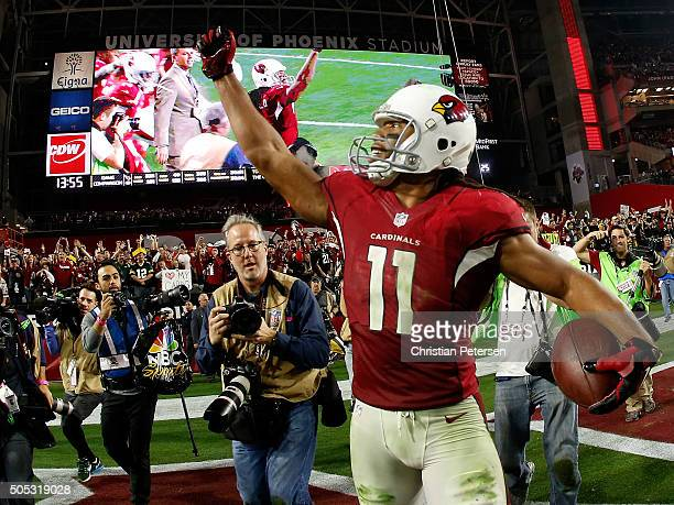 Wide receiver Larry Fitzgerald of the Arizona Cardinals celebrates his game winning touchdown in overtime of the NFC Divisional Playoff Game at...