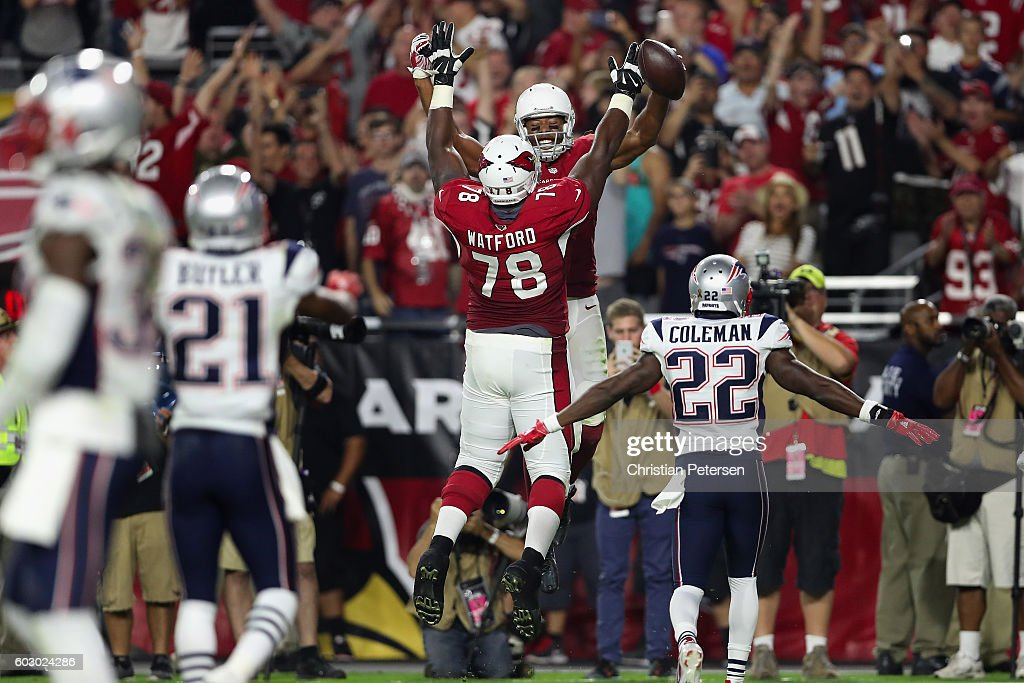 Wide receiver Larry Fitzgerald #11 of the Arizona Cardinals celebrates his 100th career touchdown with offensive tackle Earl Watford #78 during the fourth quarter of the NFL game against the New England Patriots at the University of Phoenix Stadium on September 11, 2016 in Glendale, Arizona.