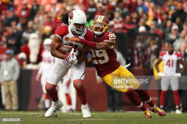 Wide Receiver Larry Fitzgerald of the Arizona Cardinals is tackled by cornerback Kendall Fuller of the Washington Redskins in the first quarter at...