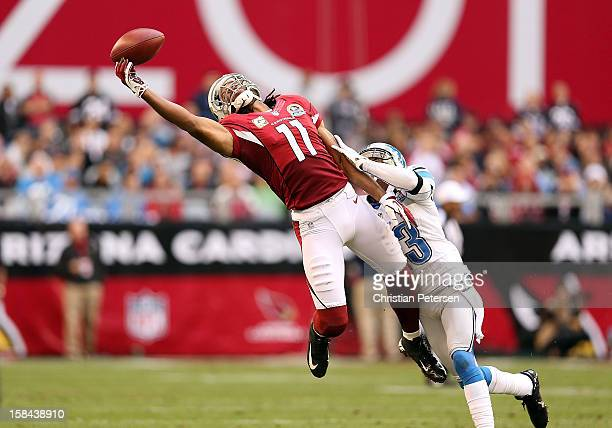 Wide receiver Larry Fitzgerald of the Arizona Cardinals is unable to make a leaping reception under pressure from cornerback Chris Houston of the...
