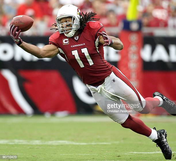 Wide receiver Larry Fitzgerald of the Arizona Cardinals is unable to catch a pass during the NFL game against the San Francisco 49ers at the...