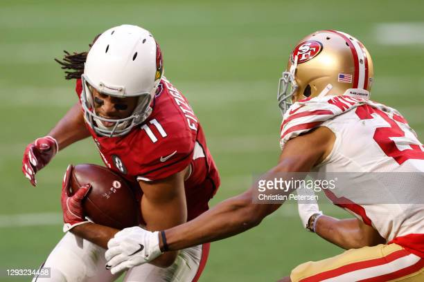 Wide receiver Larry Fitzgerald of the Arizona Cardinals makes a reception as cornerback Ahkello Witherspoon of the San Francisco 49ers defends during...