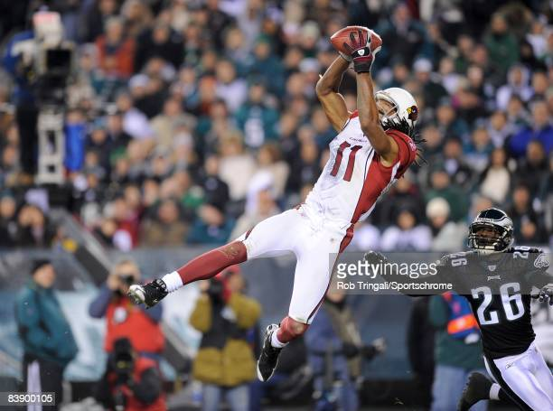 Wide receiver Larry Fitzgerald of the Arizona Cardinals makes a leaping catch as cornerback Lito Sheppard of the Philadelphia Eagle defends s at...