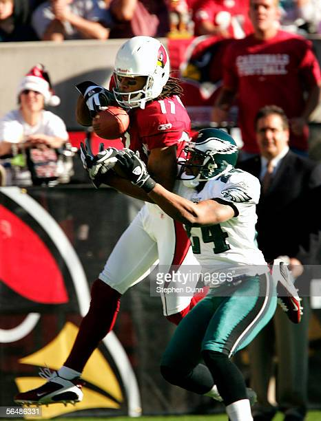 Wide receiver Larry Fitzgerald of the Arizona Cardinals makes a catch over cornerback Sheldon Brown of the Philadelphia Eagles on December 24 2005 at...