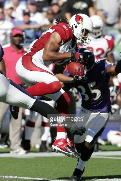 Wide receiver Larry Fitzgerald of the Arizona Cardinals makes a catch in tight coverage during a game against the Baltimore Ravens on September 23,...
