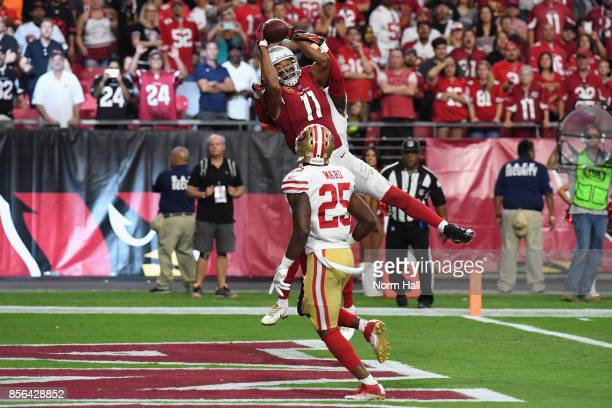 Wide receiver Larry Fitzgerald of the Arizona Cardinals makes the game winning catch in the end zone during overtime in the NFL game against the San...