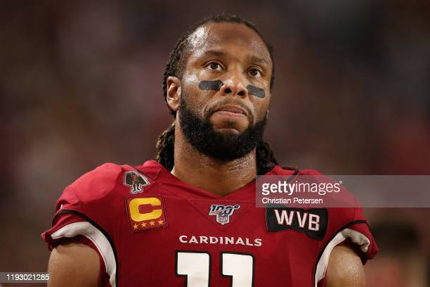 Wide receiver Larry Fitzgerald of the Arizona Cardinals on the sidelines during the second half of the NFL game against the Pittsburgh Steelers at...