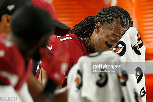 Wide receiver Larry Fitzgerald of the Arizona Cardinals reacts on the bench in the second half while taking on the Green Bay Packers in the NFC...