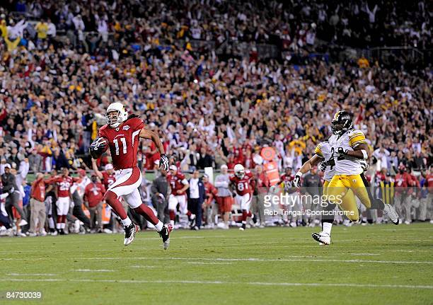 Wide receiver Larry Fitzgerald of the Arizona Cardinals runs for a touchdown in the fourth quarter against the Pittsburgh Steelers during Super Bowl...
