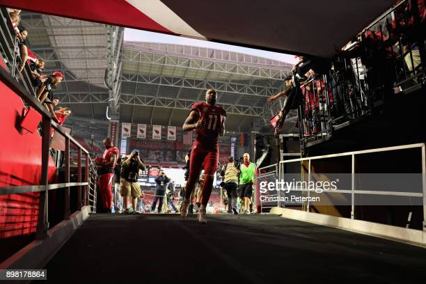 Wide receiver Larry Fitzgerald of the Arizona Cardinals runs off the field following the NFL game against the New York Giants at the University of...