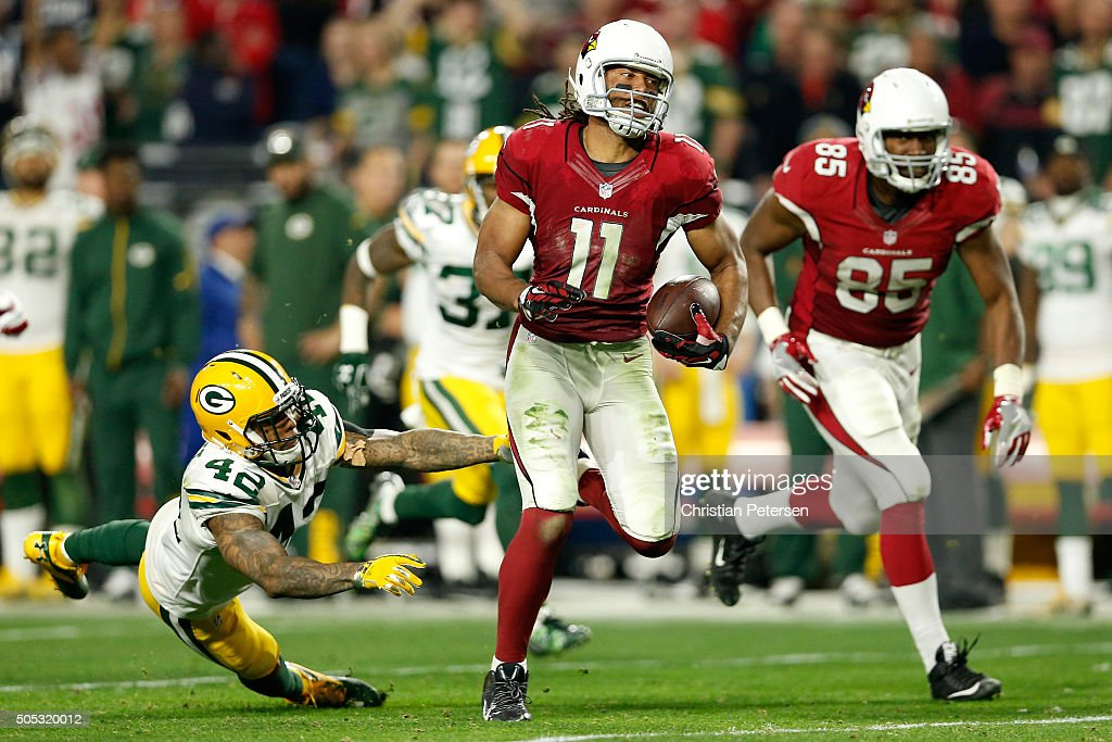 Wide receiver Larry Fitzgerald #11 of the Arizona Cardinals runs past strong safety Morgan Burnett #42 of the Green Bay Packers for a 75-yard run in overtime of the NFC Divisional Playoff Game at University of Phoenix Stadium on January 16, 2016 in Glendale, Arizona. The Arizona Cardinals beat the Green Bay Packers 26-20.