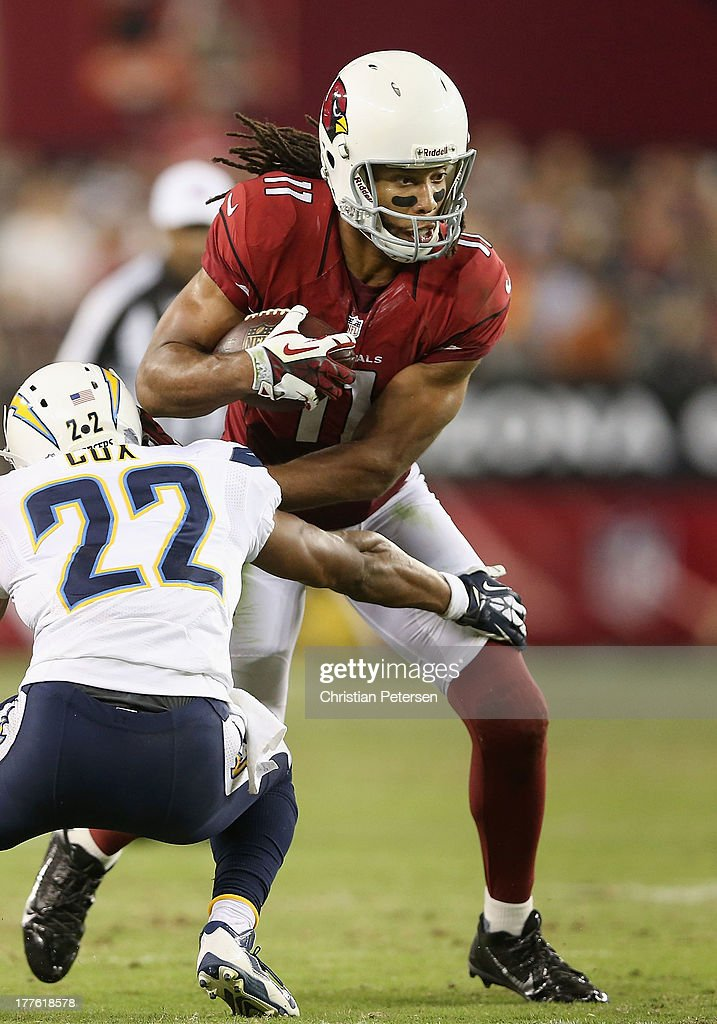 Wide receiver Larry Fitzgerald #11 of the Arizona Cardinals runs with the football after a reception during the preseason NFL game against the San Diego Chargers at the University of Phoenix Stadium on August 24, 2013 in Glendale, Arizona.