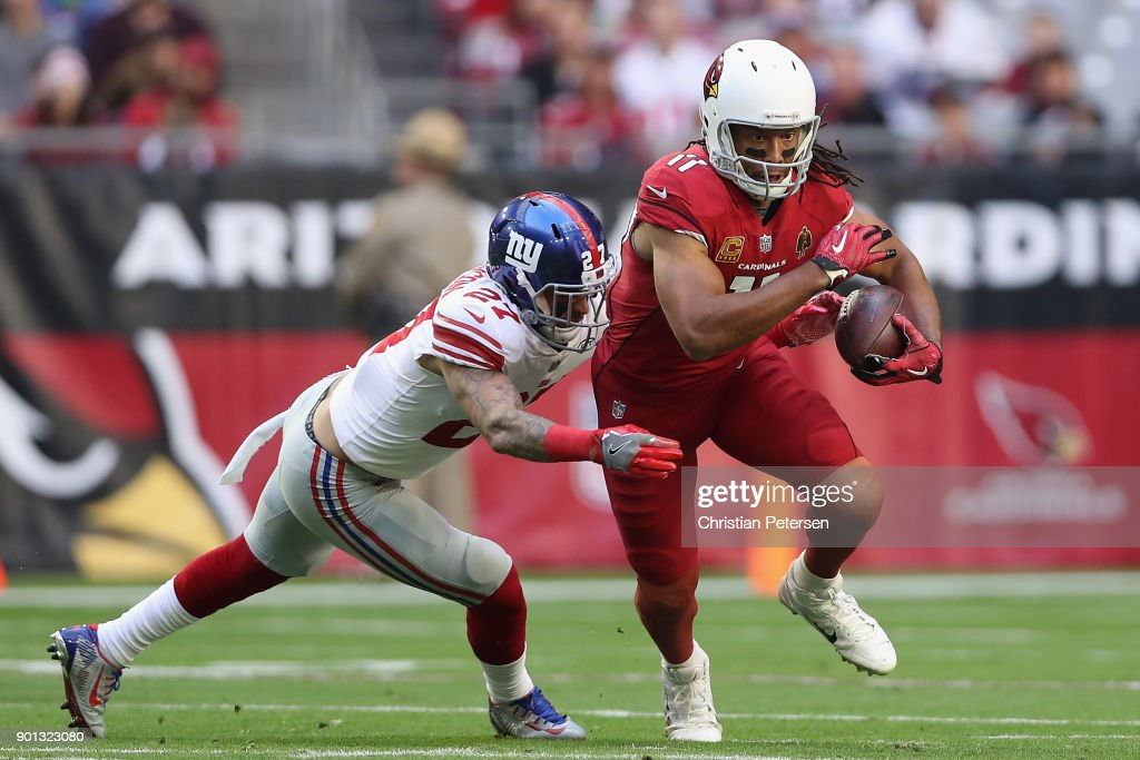 Wide receiver Larry Fitzgerald #11 of the Arizona Cardinals runs with the football after a reception past free safety Darian Thompson #27 of the New York Giants during the first half of the NFL game at the University of Phoenix Stadium on December 24, 2017 in Glendale, Arizona. The Cardinals defeated the Giants 23-0.