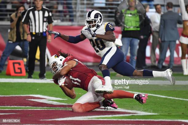 Wide receiver Larry Fitzgerald of the Arizona Cardinals scores a touchdown over free safety Lamarcus Joyner of the Los Angeles Rams during the second...