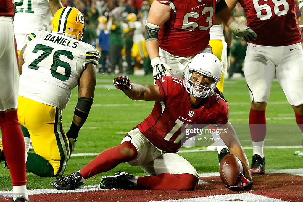 Wide receiver Larry Fitzgerald #11 of the Arizona Cardinals scores the game winning touchdown in overtime of the NFC Divisional Playoff Game at University of Phoenix Stadium on January 16, 2016 in Glendale, Arizona. The Arizona Cardinals beat the Green Bay Packers 26-20.