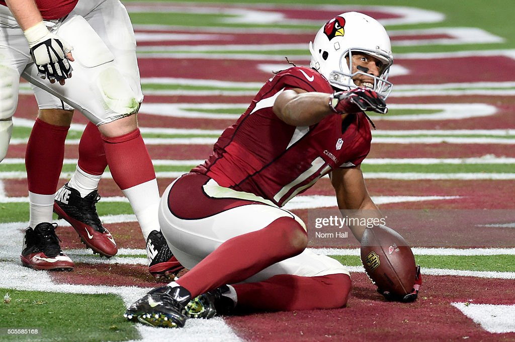 Wide receiver Larry Fitzgerald #11 of the Arizona Cardinals scores the game winning touchdown in overtime of the NFC Divisional Playoff Game against the Green Bay Packers at University of Phoenix Stadium on January 16, 2016 in Glendale, Arizona. The Arizona Cardinals beat the Green Bay Packers 26-20.