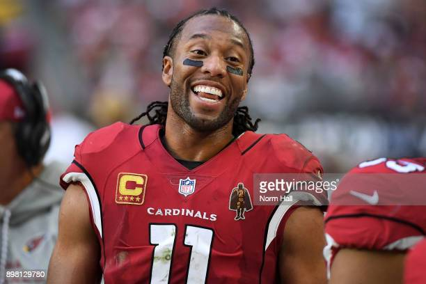 Wide receiver Larry Fitzgerald of the Arizona Cardinals smiles after scoring a touchdown in the first half of the NFL game against the New York...