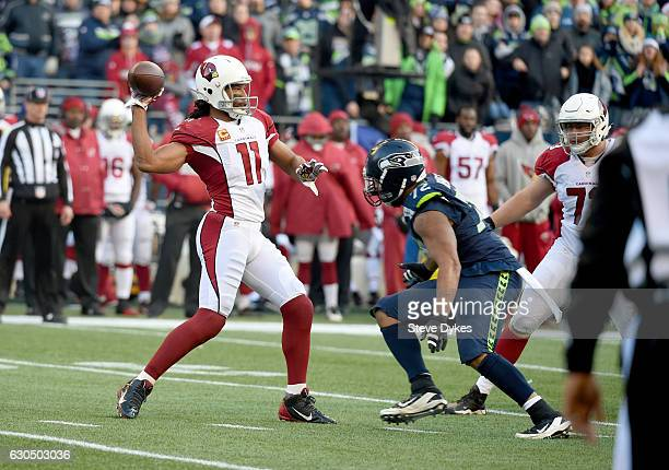 Wide receiver Larry Fitzgerald of the Arizona Cardinals throws a pass against the Seattle Seahawks at CenturyLink Field on December 24 2016 in...
