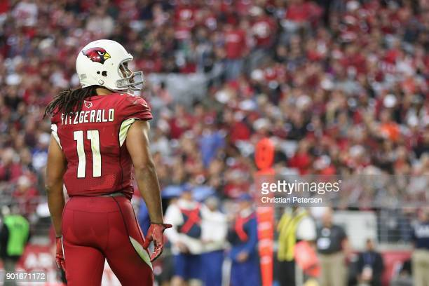 Wide receiver Larry Fitzgerald of the Arizona Cardinals walks off the field during the second half of the NFL game against the New York Giants at the...