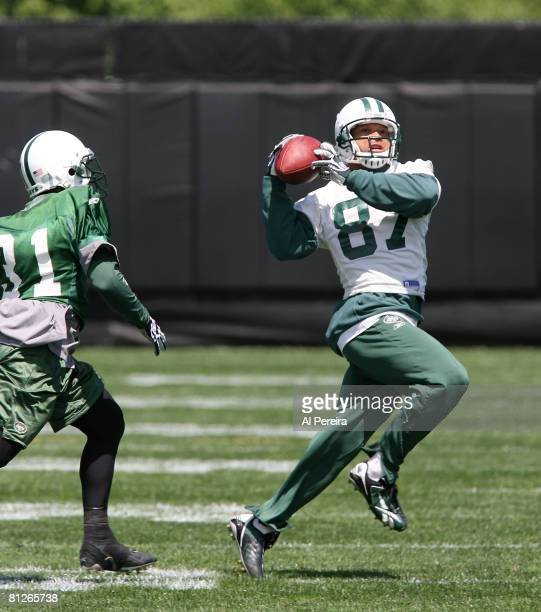 Wide receiver Laveranues Coles of the New York Jets catches a long pass in Organized Team Activities at the Jets Training Facility May 28, 2008 in...
