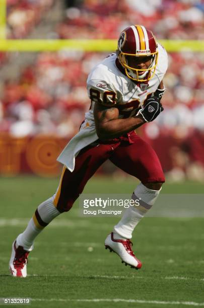 Wide receiver Laveranues Coles of the Washington Redskins runs the pattern during the game against the Tampa Bay Buccaneers at FedEx Field on...