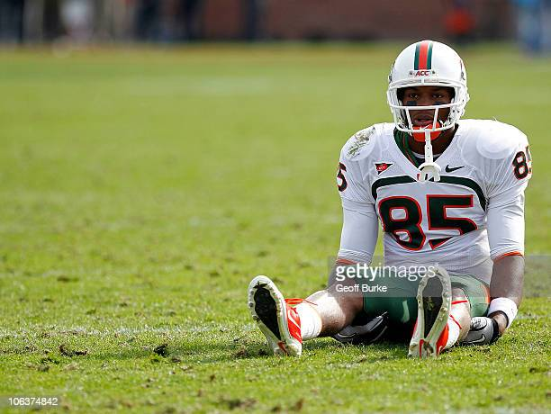 Wide receiver Leonard Hankerson of the Miami Hurricanes sits on the field against the Virginia Cavaliers at Scott Stadium on October 30, 2010 in...