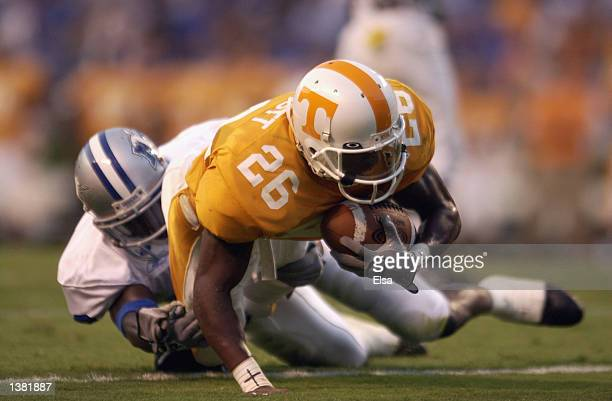 Wide receiver Leonard Scott of the Tennessee Volunteers stretches for extra yardage during the NCAA football game against the Middle Tennessee State...