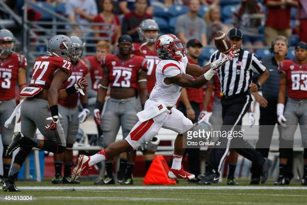 Wide receiver Leonte Carroo of the Rutgers Scarlet Knights makes a touchdown catch on the first play of the game against the Washington State Cougars...