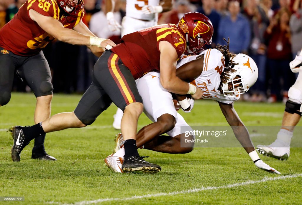 Wide receiver Lil'Jordan Humphrey #84 of the Texas Longhorns is tackled by linebacker Joel Lanning #7 of the Iowa State Cyclones as he rushed for yards in the second half of play at Jack Trice Stadium on September 28, 2017 in Ames, Iowa. The Texas Longhorns won 17-7 over the Iowa State Cyclones.