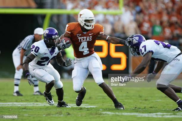 Wide receiver Limas Sweed of the Texas Longhorns fends off safety David Roach and cornerback Nick Sanders of the TCU Horned Frogs after making a...