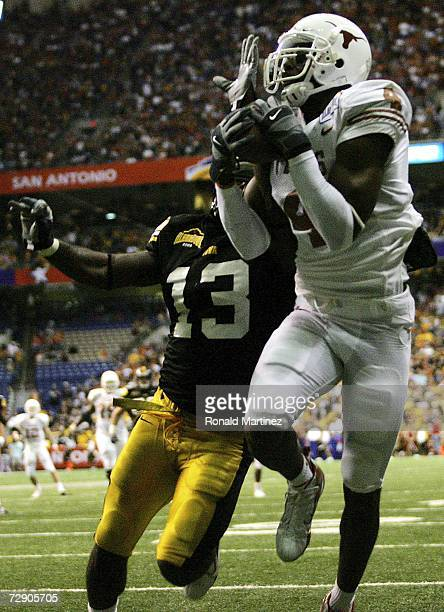 Wide receiver Limas Sweed of the Texas Longhorns makes a touchdown pass reception against Charles Godfrey of the Iowa Hawkeyes during the Alamo Bowl...