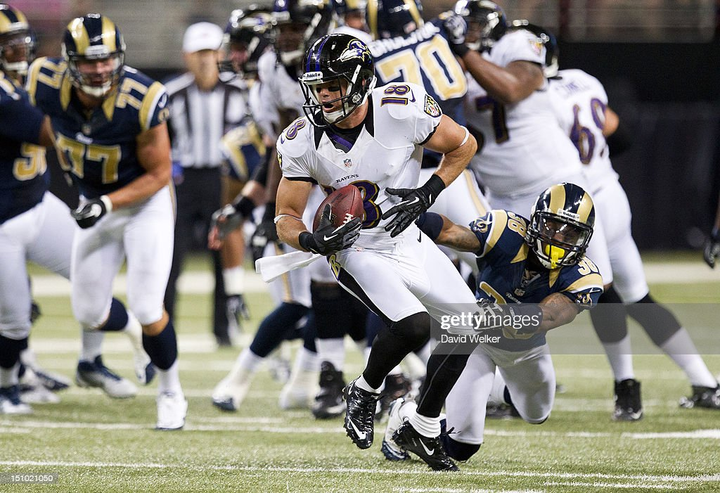Wide receiver Logan Payne #18 of the Baltimore Ravens breaks free from a tackle during the game against the St. Louis Rams at the Edward Jones Dome on August 30, 2012 in St. Louis, Missouri. The St. Louis Rams defeated the Baltimore Ravens 31-17.