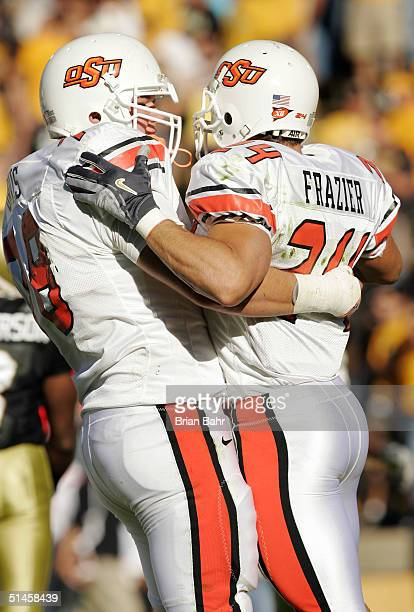 Wide receiver Luke Frazier celebrates his touchdown with Kellen Davis of the Oklahoma State Cowboys against the Colorado Buffaloes October 9 2004 at...