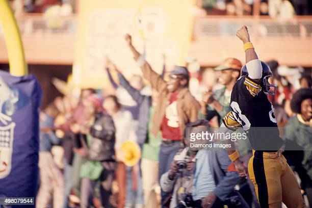 Wide receiver Lynn Swann of Pittsburgh Steelers celebrates scoring a touchdown during Super Bowl X on January 18 1976 against the Dallas Cowboys at...