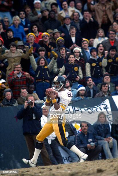Wide Receiver Lynn Swann of the Pittsburgh Steelers catches a pass against the Baltimore Colts during an NFL football game circa 1976 at Memorial...