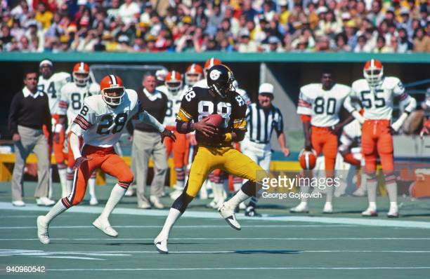 Wide receiver Lynn Swann of the Pittsburgh Steelers catches a pass near cornerback Ron Bolton of the Cleveland Browns during a game at Three Rivers...