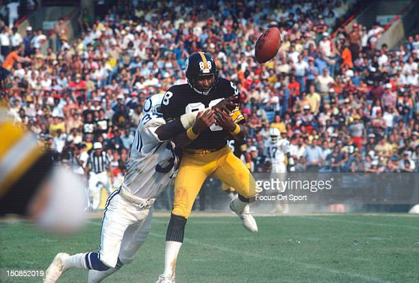 Wide Receiver Lynn Swann of the Pittsburgh Steelers has the ball knocked away from him by Reggie Pinkney of the Baltimore Colts during an NFL...