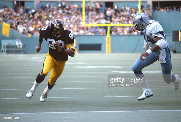 Wide Receiver Lynn Swann of the Pittsburgh Steelers is guarded by Aaron Mitchell of the Dallas Cowboys during an NFL football game October 28 1979 at...