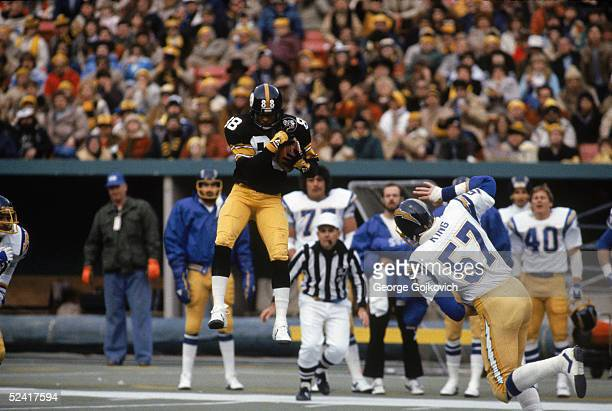 Wide receiver Lynn Swann of the Pittsburgh Steelers makes a catch during a 1982 NFL game against the San Diego Chargers at Three Rivers Stadium in...